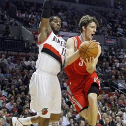 Houston Rockets guard Goran Dragic, right, from Slovenia, looks to pass as Portland Trail Blazers forwardLaMarcus Aldridge defends during the first quarter of their NBA basketball game in Portland, Ore., Monday, April 9, 2012.