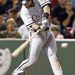 Jayson Nix of the White Sox strokes an RBI single in Thursday's game against Boston.
