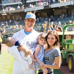 Oakland A's centerfielder Jaycob Brugman with his wife Ali, daughter Millie and sleeping son Beck.
