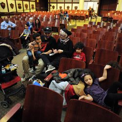 Parents came to support their son and carefully writes down spelling of all contest words during annual Citywide Spelling Bee Championship at the Lindblom Math and Science Academy on March 14, 2019. The winner will earn the opportunity to represent Chicago Public Schools at the Scripps National Spelling Bee in Washington, D.C., where they will compete against the best spellers from across the nation for the title of 2019 national Spelling Bee Champion and an opportunity to win a $40,000 prize. | Victor Hilitski/For the Sun-Times