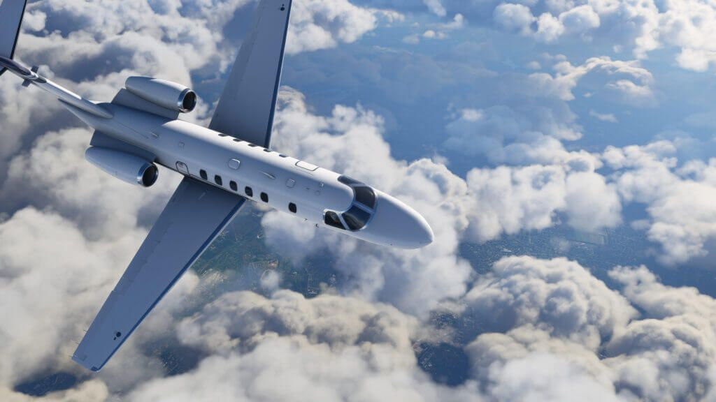 a twin-engine jet high above patchy clouds in Microsoft Flight Simulator