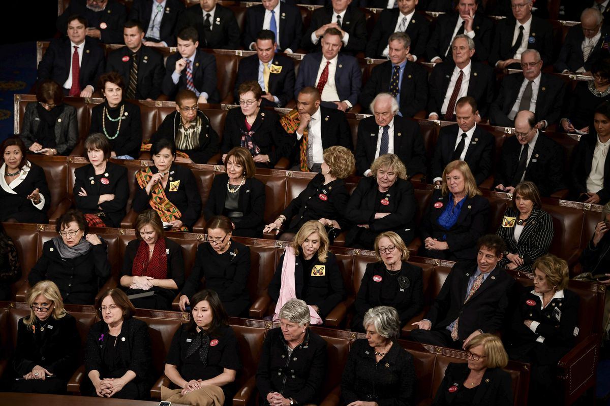 Members of Congress wearing black in solidarity with the #MeToo and Time's Up movements listen as US President Donald Trump delivers the State of the Union address at the US Capitol in Washington, DC, on January 30, 2018.