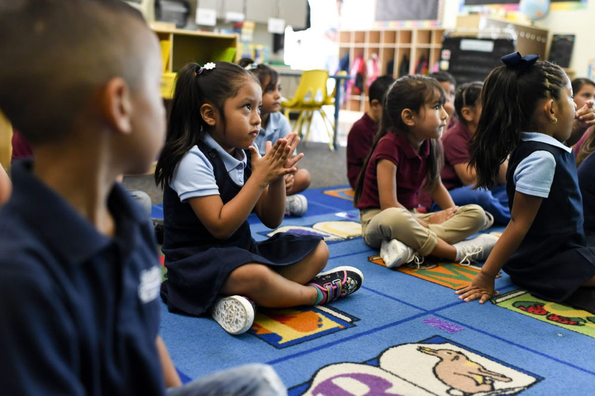 Sophia Camacena sits with classmates in kindergarten on the first day of school at McGlone Academy in Denver on Aug. 15, 2018.
