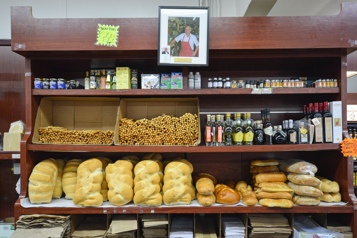 A shelf full of freshly-baked breads of different variety.