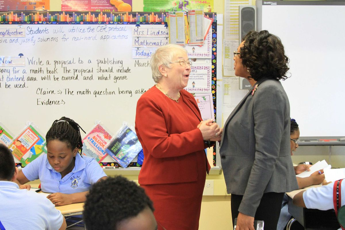 Chancellor Carmen Fariña speaks with Monique Campbell, the principal of The School of Integrated Learning, one of the city schools that will begin absorbing a struggling middle school next year.