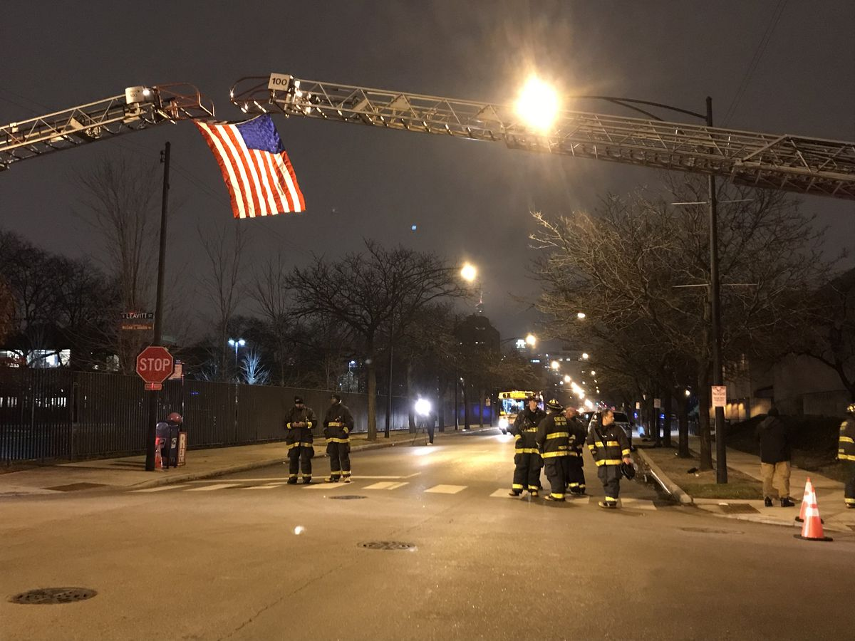 First responders prepare for police officer Samuel Jimenez's body to arrive at the Cook County medical examiner's office.   Tyler LaRiviere/Chicago Sun-Times