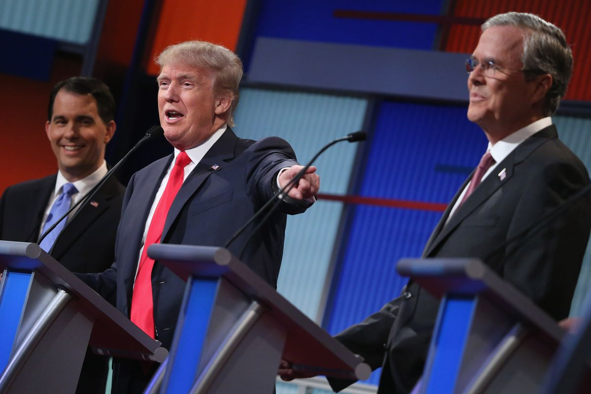 Republican presidential candidates Wisconsin Gov. Scott Walker, Donald Trump, and Jeb Bush participate in the first prime-time presidential debate hosted by Fox News and Facebook at the Quicken Loans Arena August 6, 2015, in Cleveland, Ohio.