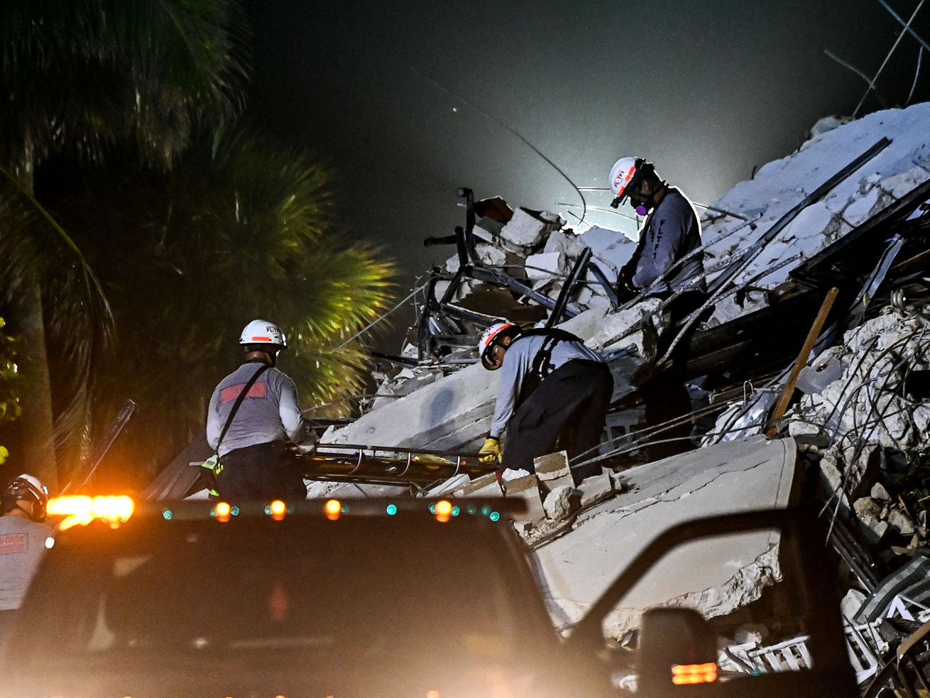 Rescue personnel remove a body from the rubble after the partial collapse of the Champlain Towers South in Surfside, north of Miami Beach, last week.