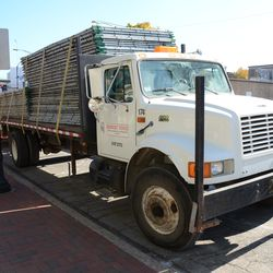11:42 a.m. Truck loaded with fences, waiting on Addison Street -