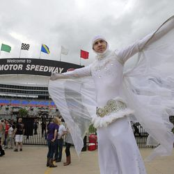"""Matt Deaton,dressed as """"Moth Man""""  takes in the wind before the NASCAR Sprint Cup Series auto race at Texas Motor Speedway Saturday, April 14, 2012, in Fort Worth, Texas."""