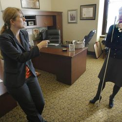 Juliette Tennert, left, deputy director and chief economist of the Governor's Office of Management and Budget, and Kristen Cox, executive director of the office, discuss the effect of a federal government shutdown on Utah at the state Capitol on Monday, Sept. 30, 2013, in Salt Lake City.