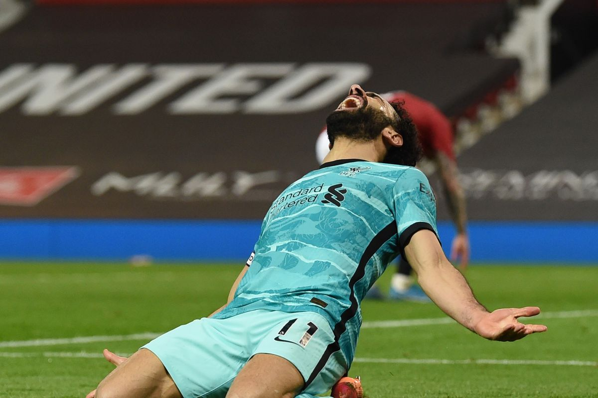 Mohamed Salah of Liverpool knee-slides to celebrate after scoring the fourth goal during the Premier League match between Manchester United and Liverpool at Old Trafford