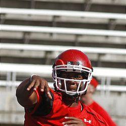 Utah quarterback Terrance Cain throws a pass during Monday's practice.
