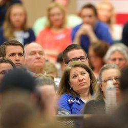 Crowd members listen as Ohio Gov. John Kasich speaks in the Grande Ballroom at UVU Friday, March 18, 2016.