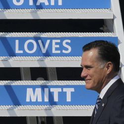 Republican presidential candidate and former Massachusetts Gov. Mitt Romney arrives at Salt Lake City International Airport during a visit to Utah for a pair of fundraisers Tuesday, Sept. 18, 2012, in Salt Lake City.