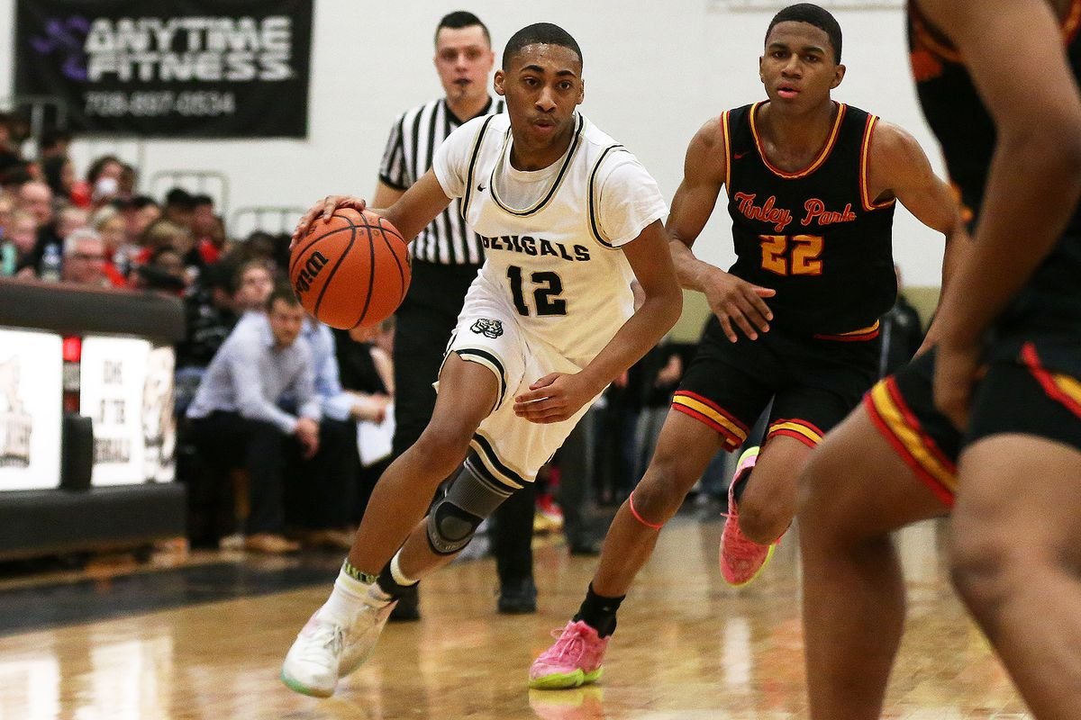 Oak Forest's Jahzeel Taylor (12) dribbles up court as the Bengals play Tinley Park.