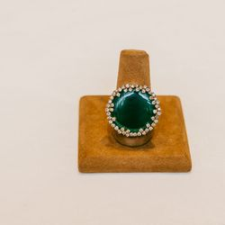 """<b>Suzanne Kalan</b> green blossom ring, <a href=""""http://www.fragments.com/green-blossom-ring-4.html?___store=default"""">$4,565</a>."""