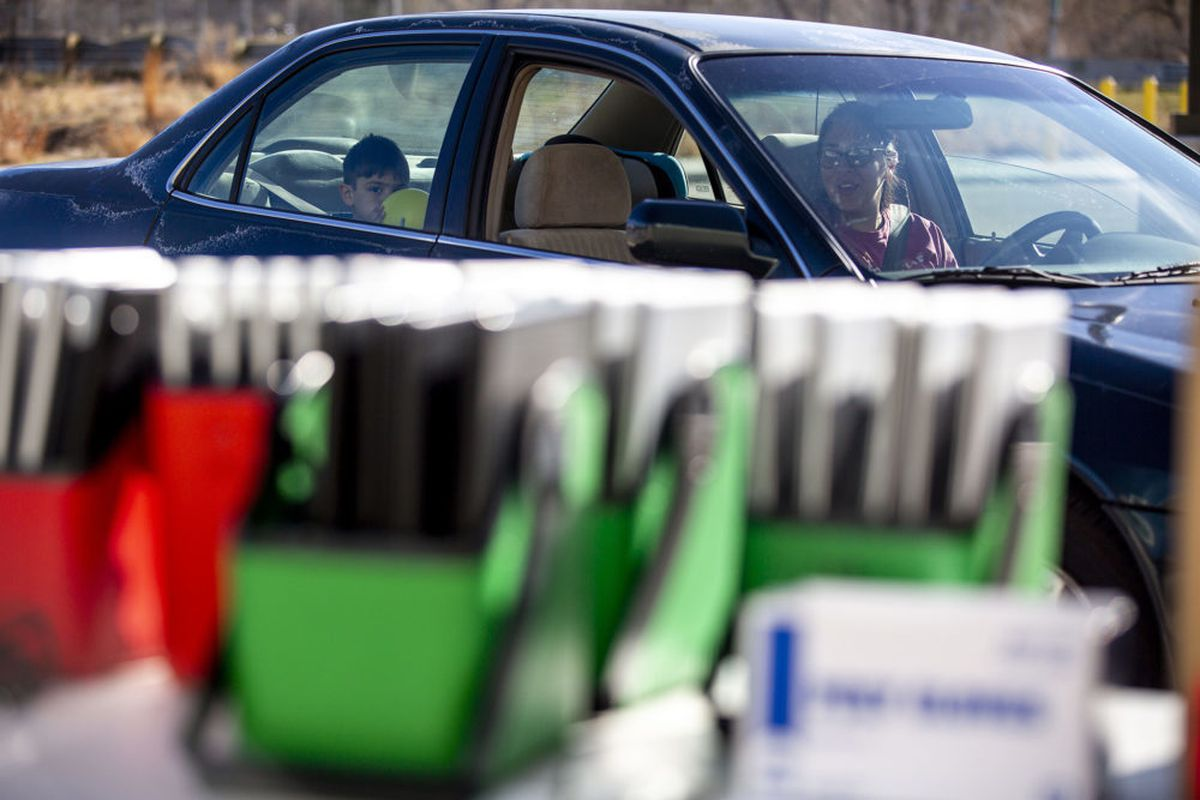 Kylie Dennison drives up to Joe Shoemaker School to get a laptop for her son as Denver students prepare for remote learning in March.