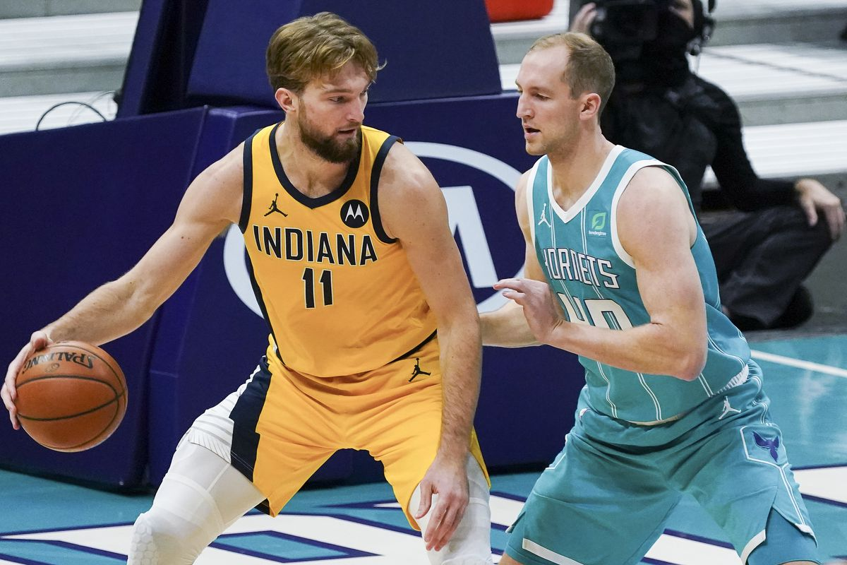 Indiana Pacers forward Domantas Sabonis (11) dribbles the ball against Charlotte Hornets center Cody Zeller (40) during the second half at Spectrum Center.