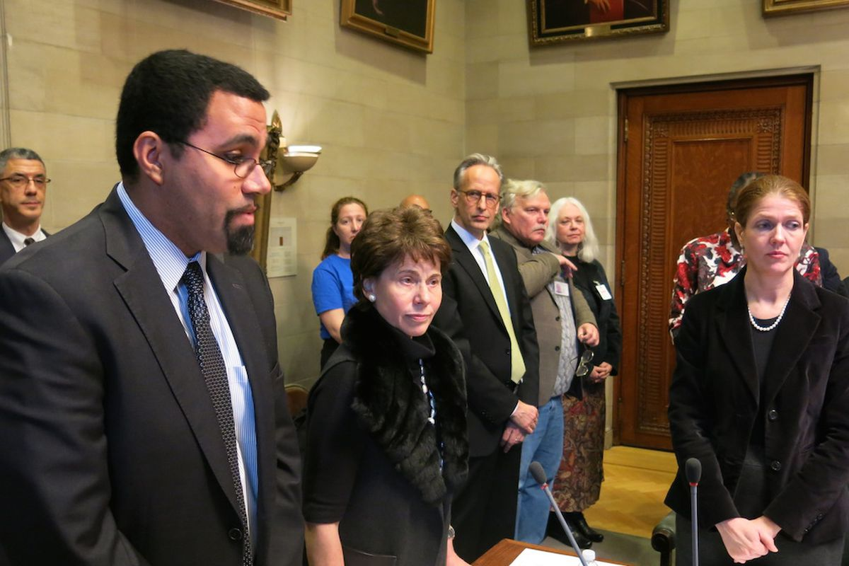Former commissioner John King and Chancellor Merryl Tisch stand with Beth Berlin, right.