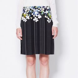 """<b>3.1 Phillip Lim</b> Midlength Straight Skirt in black, <a href=""""http://www.31philliplim.com/shop/category/womens/skirts#midlength-straight-skirt-w-slash-adjustable-side-zippers"""">$475</a>"""
