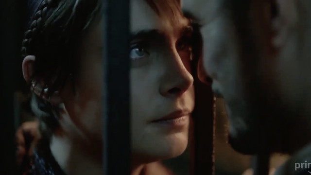 Cara Delevingne looks mournfully at Orlando Bloom through jail bars