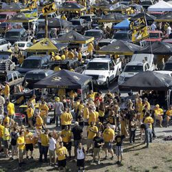 Football fans pack a parking lot before the start of an NCAA college football game between Georgia and Missouri Saturday, Sept. 8, 2012, in Columbia, Mo. The football game will be the first for Missouri against a Southeastern Conference opponent since joining the conference.