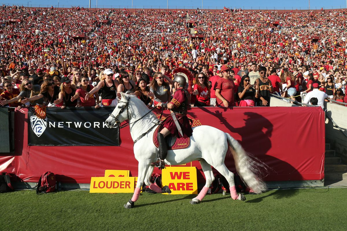 LOS ANGELES, CA:  USC Trojans mascot/designated warhorse Traveler is ridden past the student section to celebrate a touchdown scored against the Colorado Buffaloes at Los Angeles Memorial Coliseum.