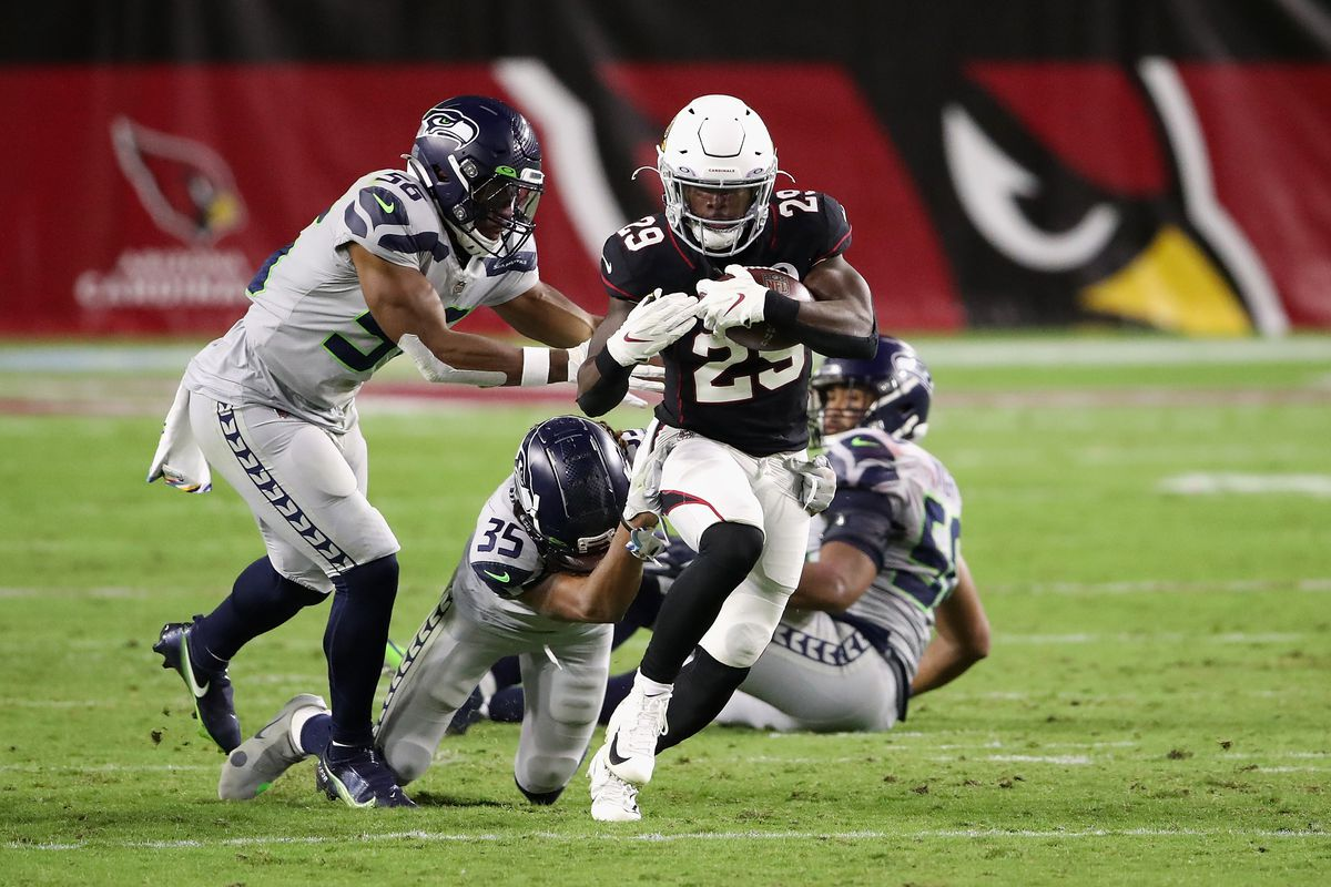 Running back Chase Edmonds #29 of the Arizona Cardinals rushes the football against the Seattle Seahawks during the NFL game at State Farm Stadium on October 25, 2020 in Glendale, Arizona. The Cardinals defeated the Seahawks 37-34 in overtime.
