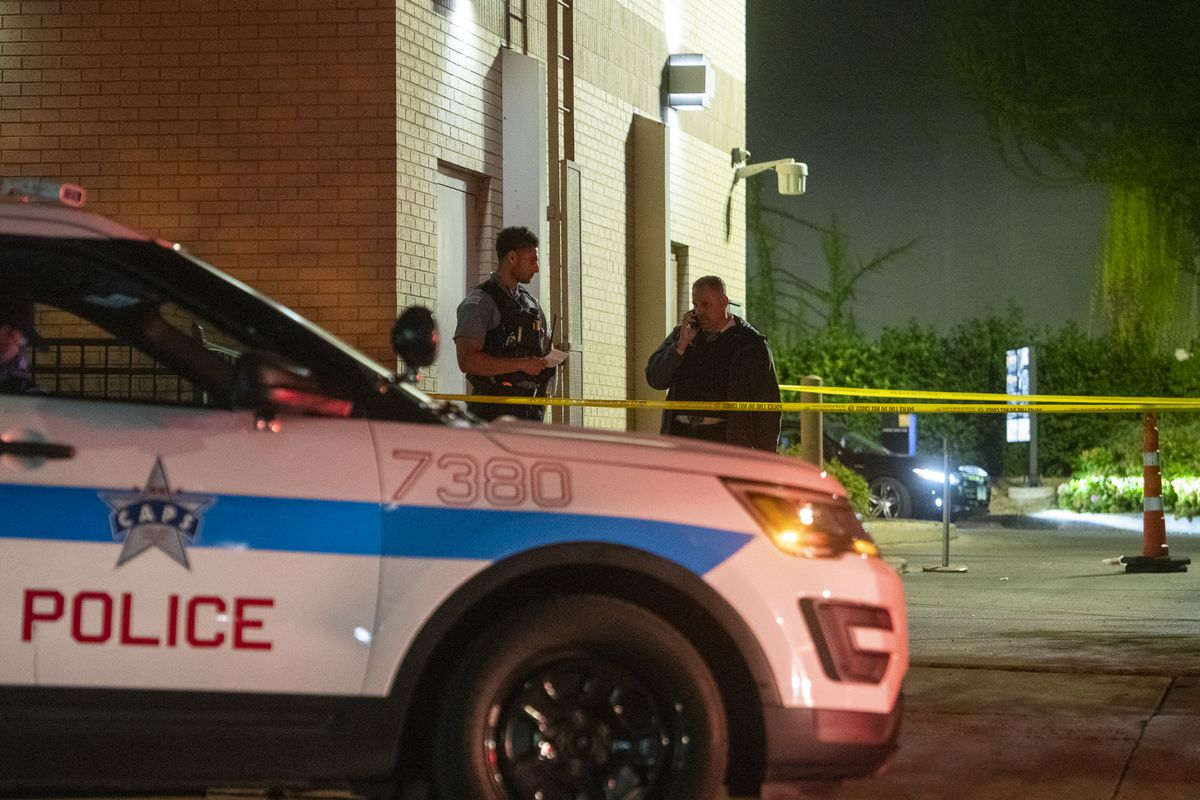 Chicago police work the scene where two teens were shot in the 5200 block of South Lake Park Ave. in the Hyde Park neighborhood, Tuesday, Sept. 21, 2021.