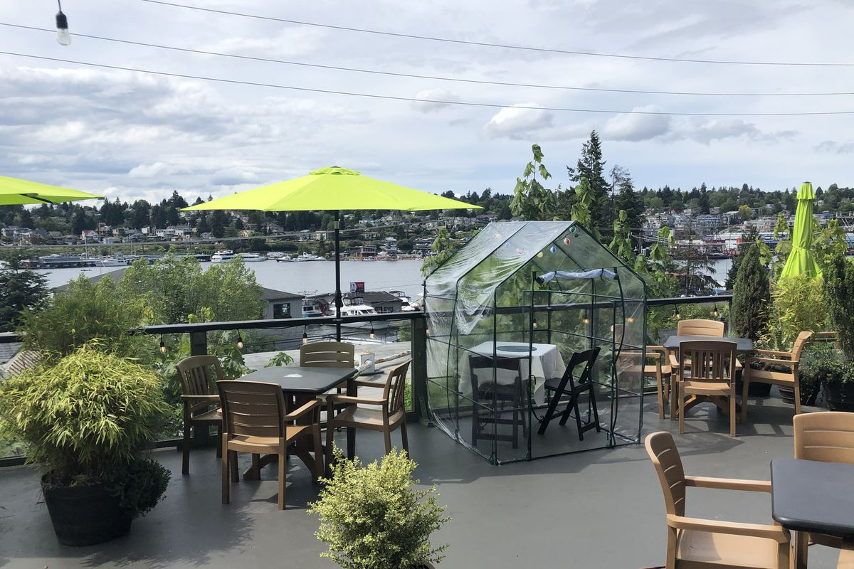 A plastic tent on the patio at Eastlake Bar & Grill, overlooking the water