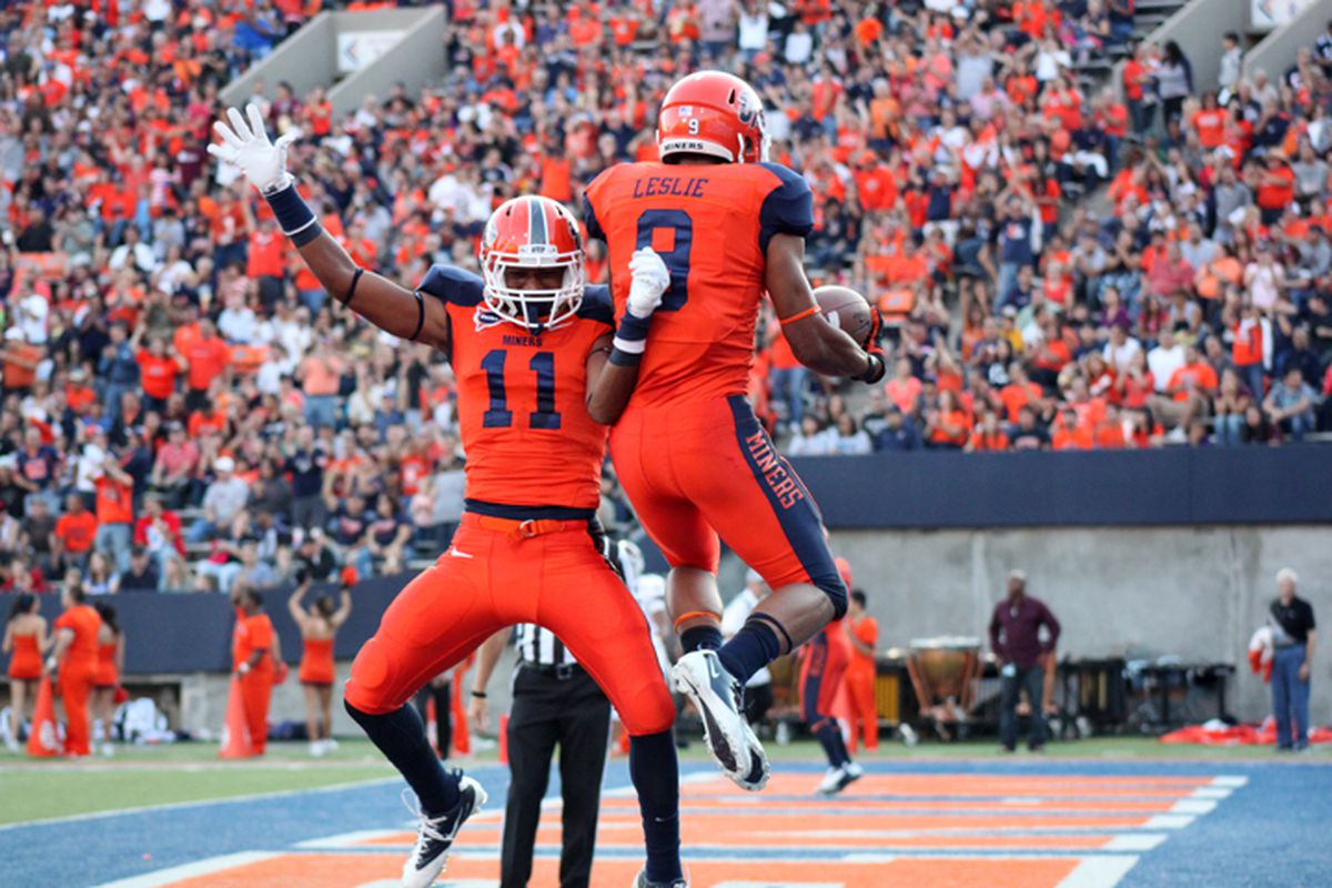 Jordan Leslie and Malcolm Trail celebrate after scoring a touchdown against NMSU Sept. 15 at the Sun Bowl.