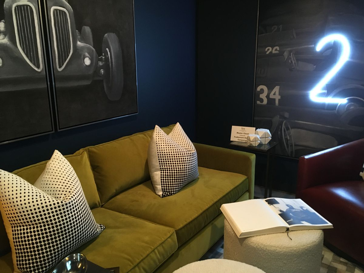 A lounge with a lighted 2 on the wall.
