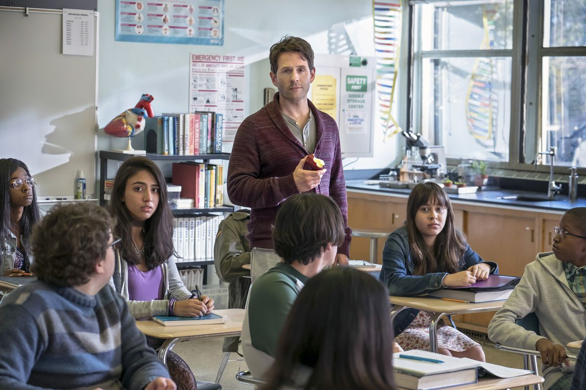 Glenn Howerton as Jack in 'A.P. Bio' eating an apple in a classroom full of students
