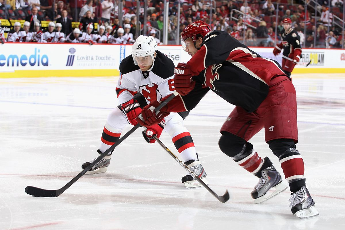 The photostream has pictures from a 2011 game between New Jersey and Phoenix.  Here are two players who can go face each other tonight: Zubrus (L) and Doan (R).