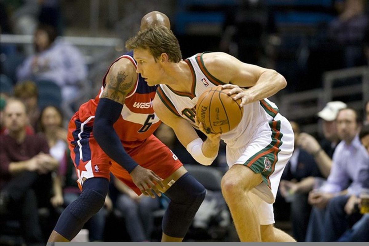 Feb 28, 2012; Milwaukee, WI, USA;  Milwaukee Bucks forward Mike Dunleavy (17) holds the ball away from Washington Wizards forward Maurice Evans (6) during the second quarter at the Bradley Center.  Mandatory Credit: Jeff Hanisch-US PRESSWIRE