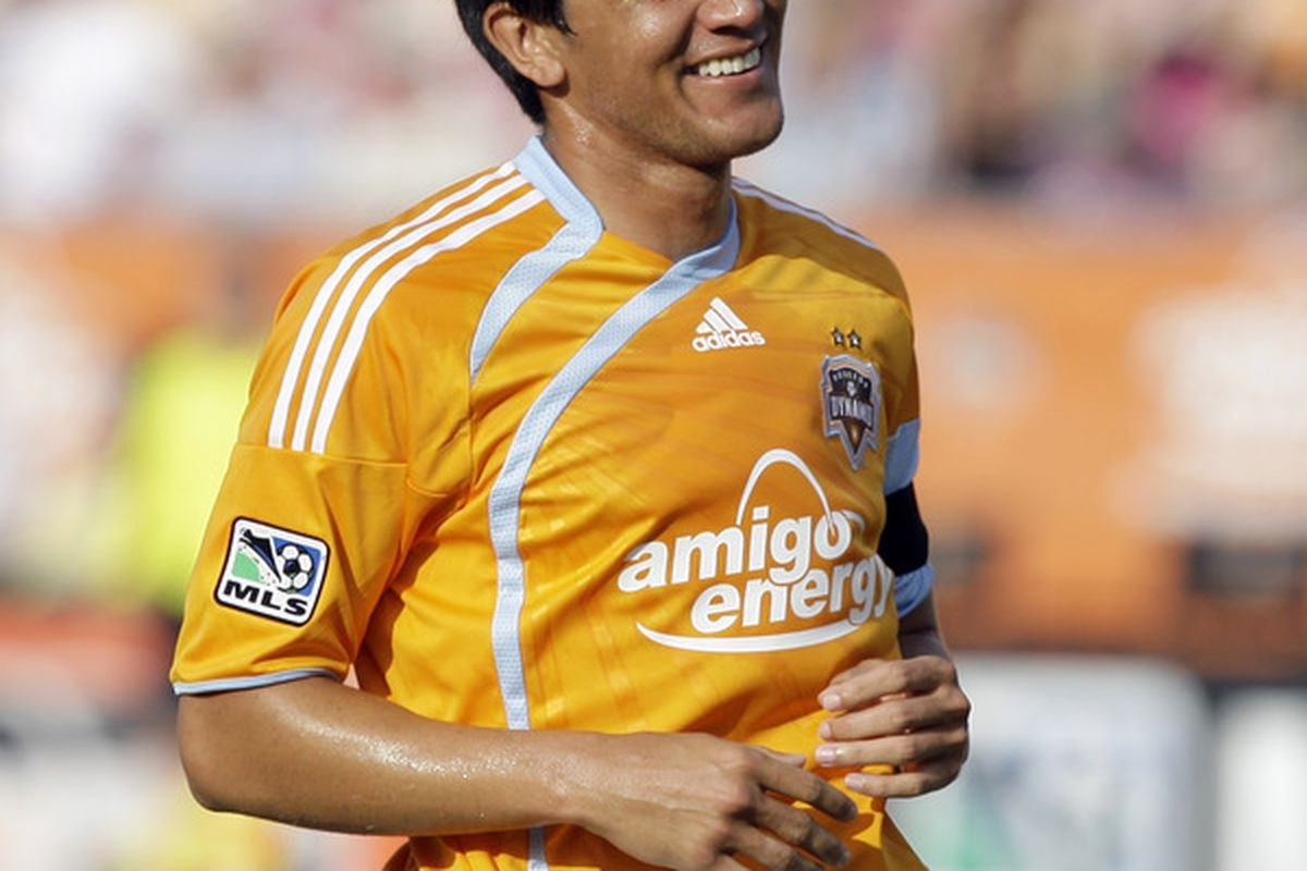Looks like former Houston Dynamo Brian Ching won't be retiring after all. Ching said that he'll report to the Montreal Impact. (Photo by Bob Levey/Getty Images)