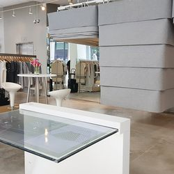 Welcome to the dressing rooms of the future, where touch-screen mirrors act as shopping concierges. Inside, a pull-out rack allows shoppers to conveniently return unwanted items or swap for sizes.