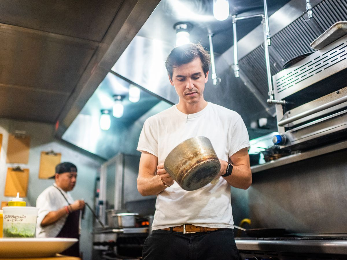 Nina May chef-owner Colin McClimans stirs a pot