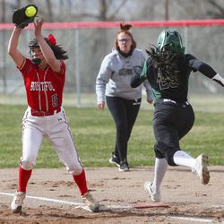 Bountiful's Shambre Maestas catches the ball just ahead of Clearfield runner Hannah Smith for an out at first during a game at Millcreek Junior High School in Bountiful on Wednesday, March 24, 2021.