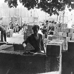 An East German worker lays some of the first stone blocks of the Berlin Wall, August 1961, shortly after the border between East and West Berlin was sealed.