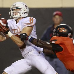 Texas wide receiver Jaxon Shipley (8) catches a touchdown pass in front of Oklahoma State safety Daytawion Lowe (8) during the first quarter of an NCAA college football game in Stillwater, Okla., Saturday, Sept. 29, 2012.