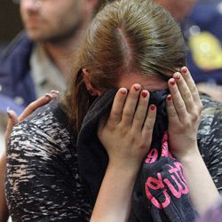 """Chelsea Patras wipes away tears as family and friends of Matthew David Stewart gather during a """"Keep the Peace"""" rally in Ogden Thursday, April 12, 2012. Stewart, a decorated former U.S. Army soldier, is charged with capital murder in the shooting death of Ogden police officer Jared Francom."""