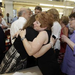 Philadelphia Inquirer reporter Susan Snyder, center left, gets a hug from editor Dotty Brown after the paper won the Pulitzer Prize for public service, Monday, April 16, 2012, in Philadelphia. The Philadelphia Inquirer won for its exploration of pervasive violence in the city's schools, using powerful print narratives and videos to illuminate crimes committed by children against children and to stir reforms to improve safety for teachers and students.