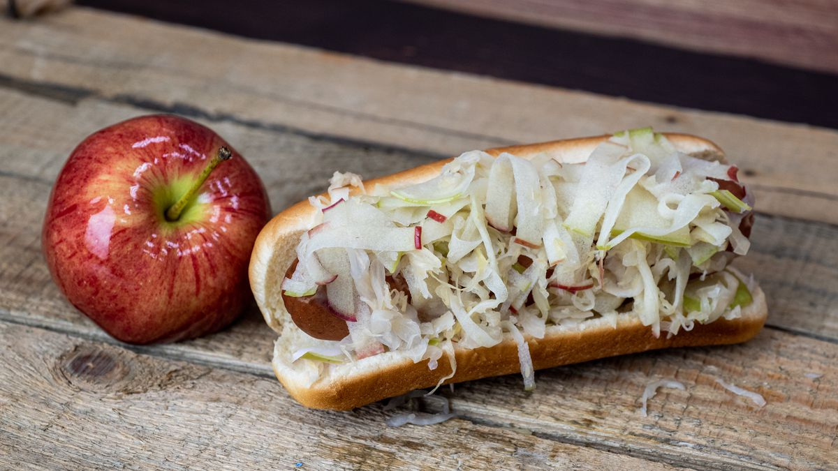 Shown is an Oberto hot link topped with apple coleslaw, available at Seattle Dog stands around CenturyLink Field.
