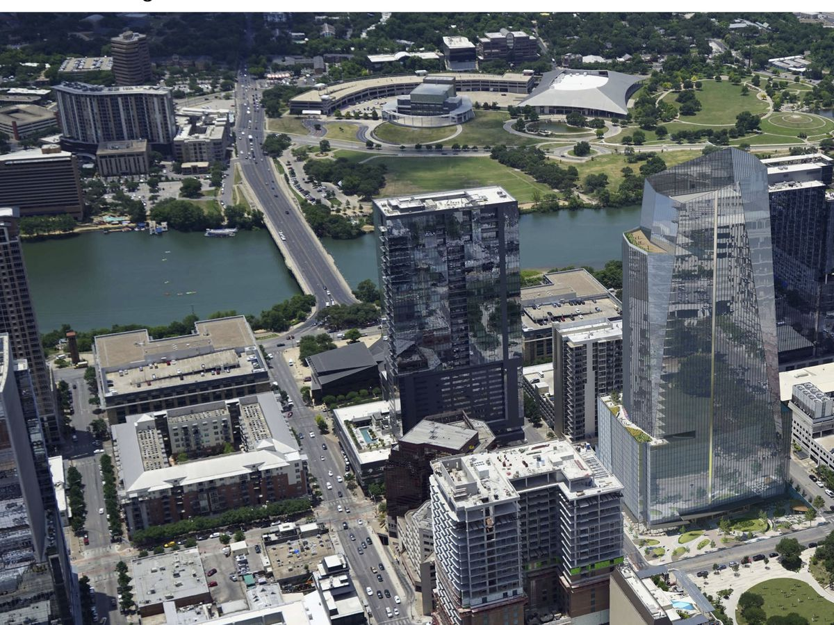 Photo illustration of a pyramidal, glass tower from above on a city block a few blocks from a river.