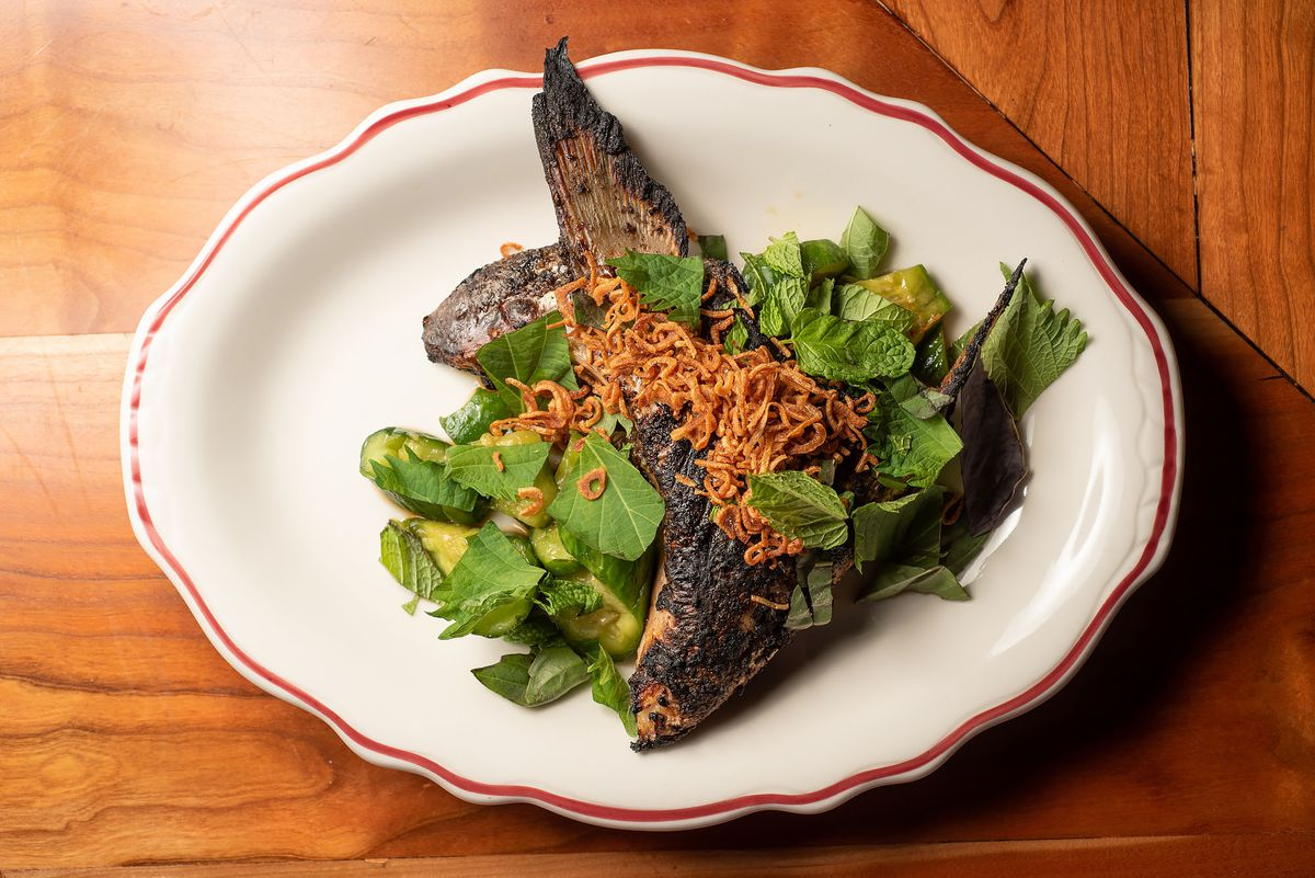 A charred fish collar on a plate.