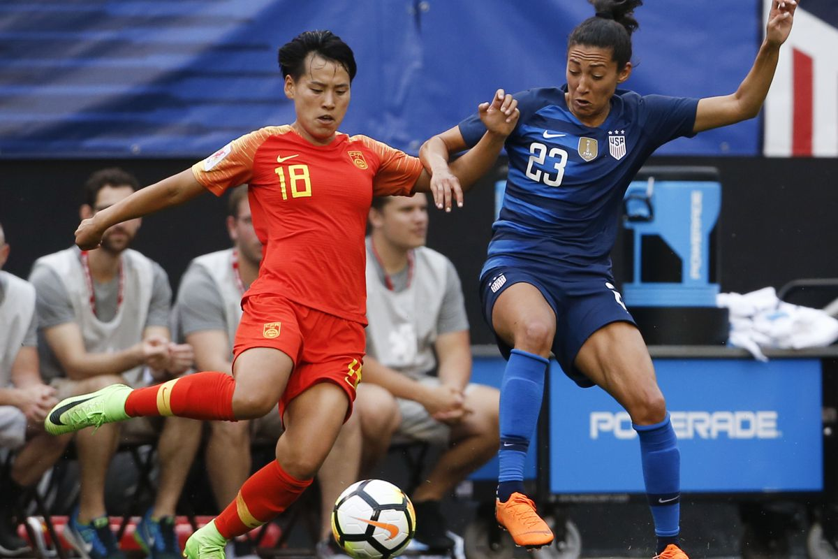 China's Han Peng (18) and United States' Christen Press (23) vie for the ball during the first half during an international friendly soccer match Tuesday, June 12, 2018, in Cleveland. The United States defeated China 2-1. (AP Photo/Ron Schwane)
