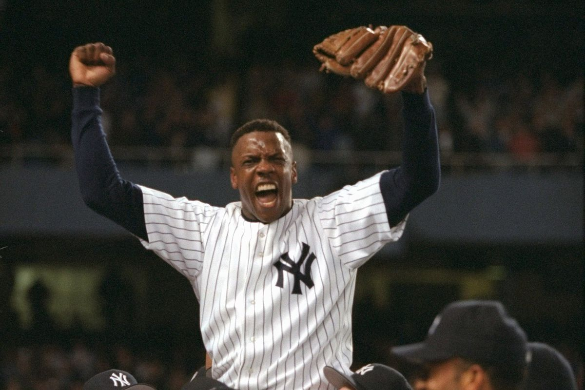 Yankees' pitcher Dwight Gooden is carried from the field by