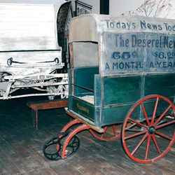 An  old-time carriage display in Lagoon's Pioneer Village showcases a 100-year-old Deseret News vendor's cart.